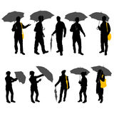 Peoples with umbrella Royalty Free Stock Photos