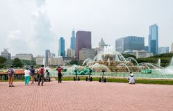 Peoples visiting Buckingham Memorial Fountain in the Chicago Grant Park. Stock Photos