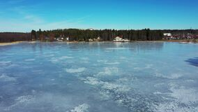Peoples are walking on the lake ice in the sunny spring day