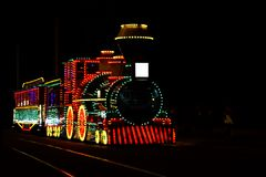Train with light decorations on display royalty free stock photo
