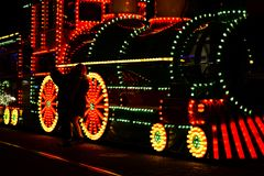 Train with light decorations on display. Peoplet taking photographs in front of Blackpool train of lights stock photos