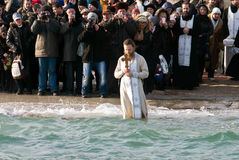 Peopls swimming in ice cold water Black Sea during Epiphany (Holy Baptism) in the Orthodox tradition Royalty Free Stock Photos