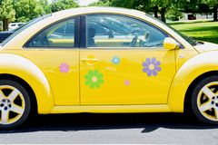 Peoria, IL/USA - 06-13-2018 Bright yellow vw bug with flower decals. On a summer day royalty free stock image