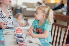 Peoria, IL/USA - 03-31-2018: Family time dyeing Easter eggs royalty free stock photography