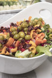 Peparation of a Salad with greens, radishes, cucmbers, olives, t Royalty Free Stock Photography