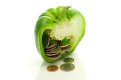 Pepe affettato con le monete. Immagini Stock Libere da Diritti