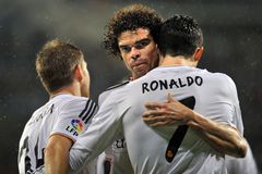 Pepe and Cristiano Ronaldo of Real Madrid hugging each other to celebrate  goal Royalty Free Stock Photos