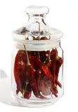 Pepe di peperoncini rossi rovente in vetro Fotografia Stock
