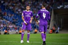 Pepe l e Sergio Ramos r jogam na harmonia de Liga do La entre CF do RCD Espanyol e do Real Madrid fotografia de stock