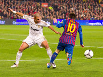 Pepe and Leo Messi. BARCELONA - JANUARY 25: Pepe Laveran (L) and Leo Messi in action during the Spanish Cup match between FC Barcelona and Real Madrid, final Royalty Free Stock Photos