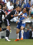 Pepe of Real Madrid. Pepe(L) of Real Madrid fight with Sergio Garcia(R) Espanyol fight during a Spanish League match against RCD Espanyol at the Power8 stadium Stock Photography