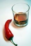 pepe rosso e vetro Fotografia Stock