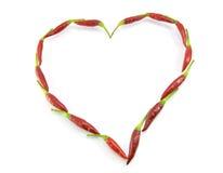 Pepe rosso in una figura di un cuore Fotografia Stock Libera da Diritti