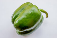 pepe verde su priorità bassa bianca Immagine Stock