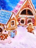 Peperkoekmens en huis dichtbij Kerstboomkoekje Stock Foto's