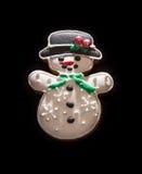 Peperkoeksneeuwman op de donkere achtergrond, Kerstmisthema Stock Foto