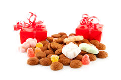 Pepernoten (ginger nuts) and presents Stock Image