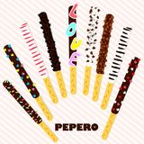 Pepero Day . South Korean chocolate sticks. Assorted biscuits covered with chocolate and festive sprinkles  on pink stripe Royalty Free Stock Photo