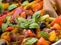 Peperonata with basil and olives Royalty Free Stock Photos