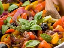 Peperonata with basil and olives Royalty Free Stock Photos