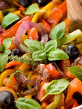 Peperonata with basil and olives Royalty Free Stock Image