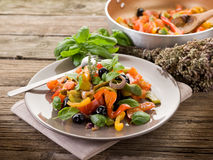 Peperonata with basil and olives Stock Image