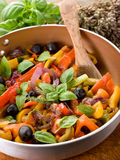 Peperonata over casserole on wood Stock Image