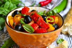 Peperonata - traditional dish of italian cuisine. Stock Photo