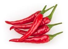 Peperoncini di cayenna rossi isolati su bianco Fotografia Stock