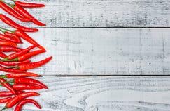 Peperoncini rossi rossi caldi e piccanti Fotografia Stock