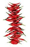 Peperoncini rossi rossi che compongono Immagini Stock Libere da Diritti