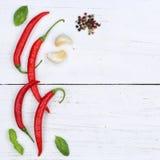Peperoncini rossi roventi dei peperoncini che cucinano il copyspace degli ingredienti squar Fotografia Stock