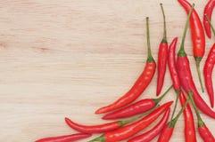 Peperoncini rossi su legno Fotografia Stock