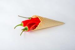 Peperoncini roventi in un cono del wafer Fotografia Stock Libera da Diritti