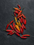 Peperoncino chilli peppers. Over a dark stone Royalty Free Stock Photo