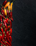 Peperoncino chilli peppers. Over a dark stone tray Royalty Free Stock Photography
