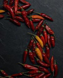 Peperoncino chilli peppers. Over a dark stone tray Royalty Free Stock Images