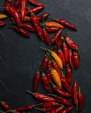 Peperoncino chilli peppers. Over a dark stone tray Stock Image