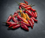Peperoncino chilli peppers. Over a dark stone tray Stock Photos