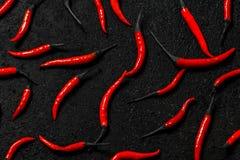 Peperoncino rosso con fumo sull'isolato su Fotografia Stock