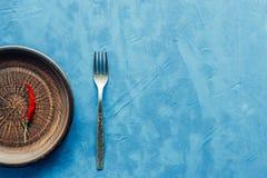 Peperoncino in un piatto Fotografia Stock