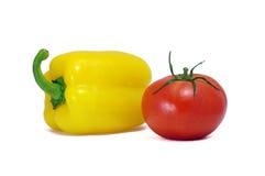 Peperone dolce giallo e pomodoro rosso Fotografia Stock