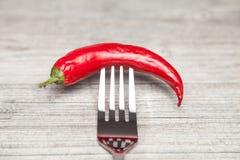 Peperoni и вилка Стоковые Изображения RF