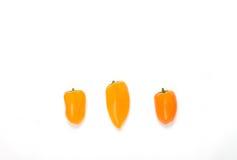 Peperoni arancio su bianco Fotografie Stock Libere da Diritti