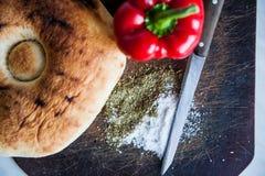 Peperoni del bordo di pane Fotografia Stock