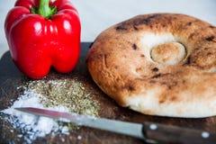 Peperoni del bordo di pane Immagini Stock Libere da Diritti