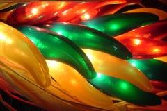 Peperoni di peperoncino rosso illuminati Fotografia Stock Libera da Diritti