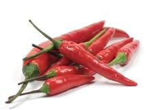 Peperoni di peperoncino rosso roventi Immagine Stock