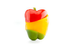 Peperoni dolci rossi, gialli e verdi in tre frammenti r della giunzione Fotografia Stock
