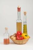 Peperoni ed olio Fotografie Stock